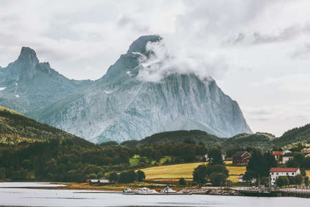 Rocky Mountains Landscape in Norway clouds rocks above village and forest Travel scenery scandinavian nature Stockfoto
