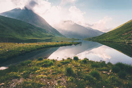 Sunset Landscape Rocky Mountains and Lake reflection with sky clouds Summer Travel serene view