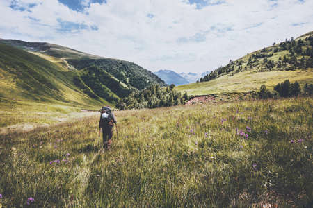 Hiking vacations at wild nature Traveler Man with backpack in mountains Travel Lifestyle concept adventure summer vacations outdoor