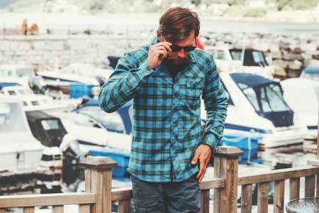 Elegant Man Fashion Lifestyle success concept businessman walking yachts on background