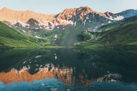 Sunset Landscape Rocky Mountains and mirror Lake reflection Summer Travel serene view Stockfoto