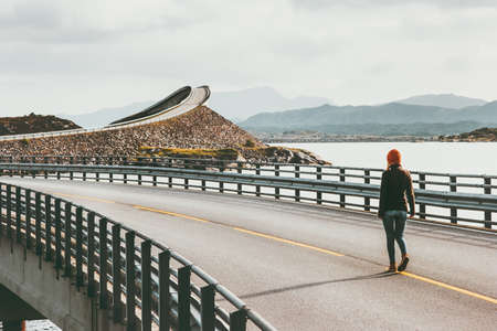 Woman walking alone at Atlantic road in Norway Storseisundet bridge Travel Lifestyle concept adventure vacations outdoor Banque d'images