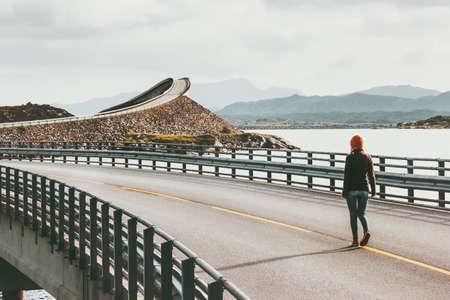 Woman walking alone at Atlantic road in Norway Storseisundet bridge Travel Lifestyle concept adventure vacations outdoor Stockfoto