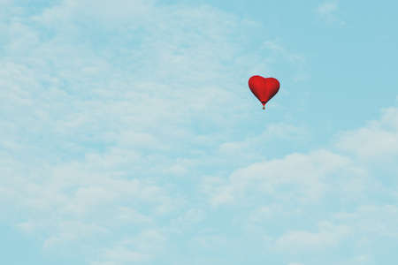 Heart shape balloon love symbol flying in the blue sky Valentines day gift celebration help and charity concept