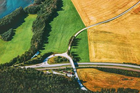 Road and geometric fields aerial view rural Landscape in Norway nature ecology concept
