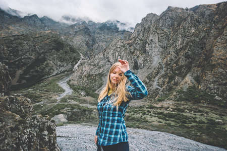 Young Woman walking in foggy mountains landscape Travel Lifestyle concept adventure vacations outdoor