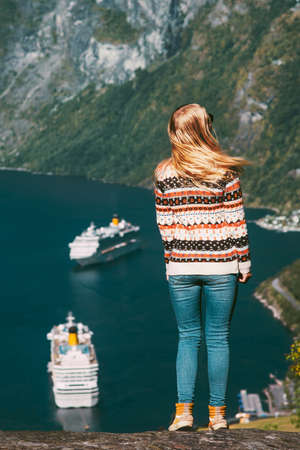 Woman tourist walking over Geiranger fjord in Norway Travel lifestyle concept active weekend summer vacations  enjoying landscape aerial view Banque d'images