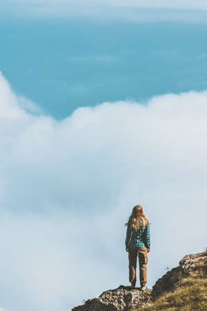 Woman on rocky cliff enjoying clouds aerial landscape Travel Lifestyle hiking adventure concept summer vacations outdoor exploring wild nature  Banque d'images