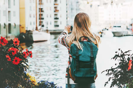 Woman with backpack walking in Alesund city Norway vacations weekend Travel Lifestyle fashion outdoor  Banque d'images