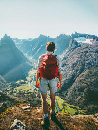 Man in Norway mountains Travel healthy lifestyle concept active weekend summer vacations tourist enjoying landscape aerial view