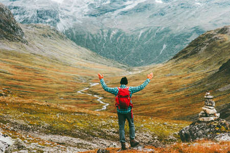 Man happy raised hands with backpack exploring mountains Travel heathy lifestyle concept active weekend summer vacations wild trek in Scandinavia Stock Photo - 91389820