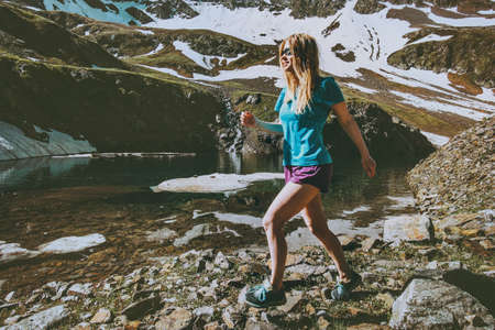 Young Woman running training outdoor in mountains Travel healthy Lifestyle concept fitness motivation active vacations