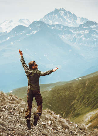 Happy Man jumping levitation in mountains Lifestyle Travel emotional success concept adventure active vacations outdoor euphoria feelings