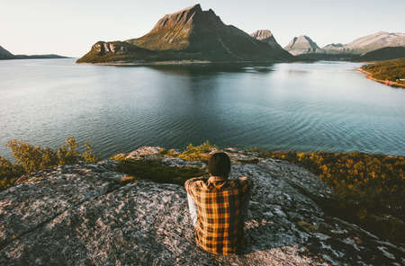 Traveler Man relaxing with sea and mountains view Travel lifestyle adventure outdoor summer vacations alone into the wild nature Stock Photo - 99352563