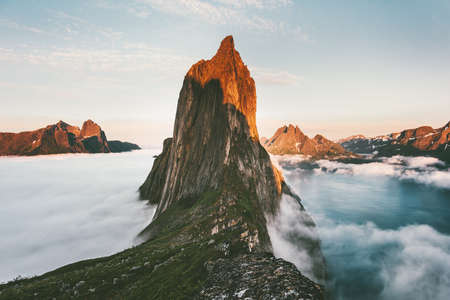 Segla Mountain sunset peak Landscape over clouds and fjord view in Norway Travel location scenery Senja islands midnight sun