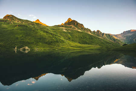 Mountains and Lake mirror reflection scenic view Landscape summer Travel ecology nature concept Imagens