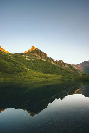 Mountains and Lake mirror reflection sunset Landscape summer Travel serene view