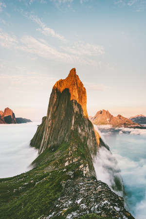 Segla Mountain sunset peak Landscape over clouds and fjord view in Norway Travel location scenery Senja islands  Imagens