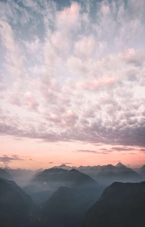 Sunset sky clouds over mountains range peaks Landscape Travel destinations wild nature scenic aerial view