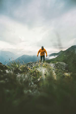 Man hiking in mountains alone Travel adventure lifestyle concept active weekend vacations in wilderness Imagens
