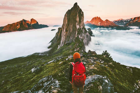 Traveler enjoying sunset Segla mountain  hiking adventure outdoor in Norway active vacations traveling lifestyle