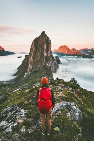Adventurous woman enjoying sunset Segla mountain hiking solo traveling outdoor in Norway active vacations backpacking healthy lifestyle