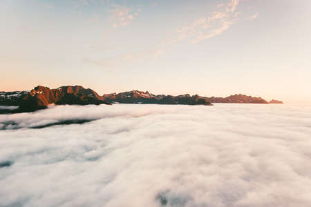 Sunset Mountains view above clouds landscape in Norway Travel aerial scenery Imagens