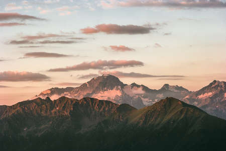 Sunset rocky mountains peaks range and clouds Landscape travel destinations wild nature tranquil scenic aerial view Imagens