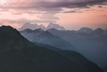 Sunset landscape rocky mountains peaks and clouds Landscape Travel locations wild nature scenic aerial view blue hour