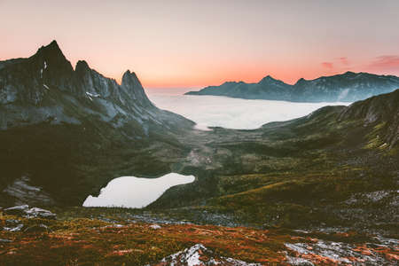 Mountains and lake Landscape aerial sunset view in Norway Travel tranquil scenery