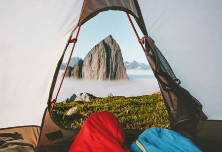 Camping tent mountain morning view travel couple in sleeping bags enjoying vacations adventure lifestyle outdoor in Norway Imagens
