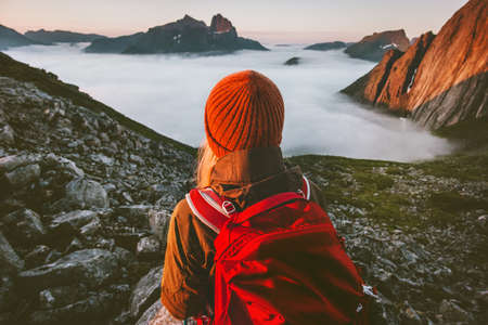 Backpacker hiking outdoor active vacations traveling adventure lifestyle woman enjoying sunset mountains Imagens