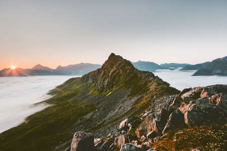 Sunrise mountain ridge over clouds. Landscape aerial beautiful morning view in Norway