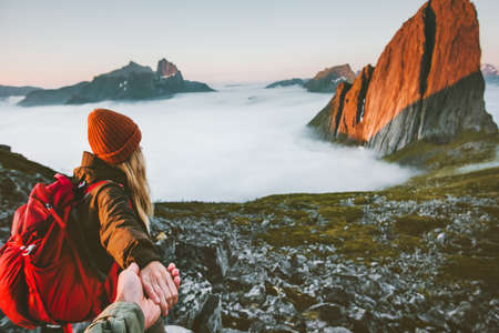 Couple romantic follow hands holding hiking in mountains Travel friendship lifestyle concept family together spending active adventure vacations modern nomads
