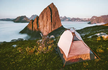 Camping tent and Segla mountain landscape in Norway