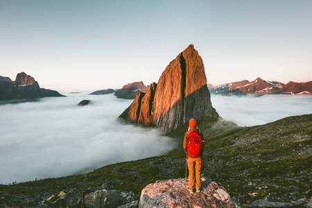 Tourist traveling enjoying sunset Segla mountain landscape hiking adventure outdoor in Norway active vacations lifestyle explorer