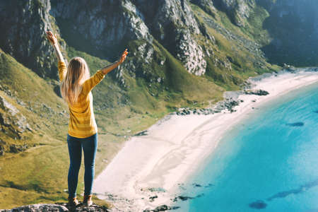 Happy woman raised hands traveling vacations sea beach healthy lifestyle outdoor