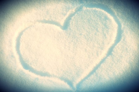 Heart Shape drawing on Snow background