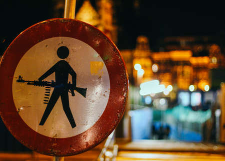 gun control: Street art in Amsterdam:  No Pedestrian Traffic sign becomes a Gun Control Law Sign: Carrying Of Weapons Prohibited Stock Photo