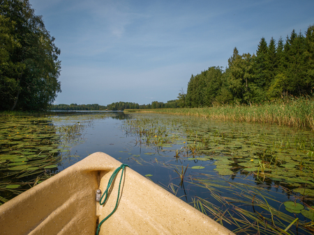 Idyllic waterways connecting the lakes of Finland between lush green forests Stock Photo
