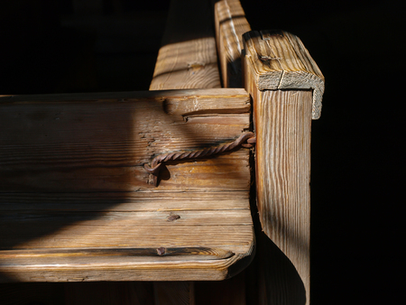 Old wooden church bench Close up in detail Stock Photo