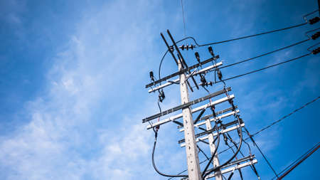 streetlights: Telephone utility poles, cables, streetlights, and blue sky background.