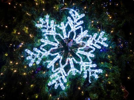 decorate: Snowflakes lighting decorate on Christmas tree.