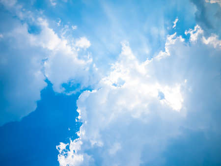 spiritual background: Blue sky with sun and beautiful clouds.