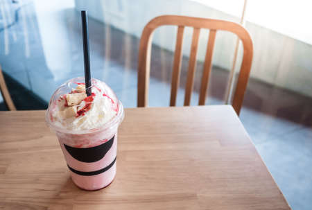 frappe: Strawberry frappe with cheesecake on top for someone.