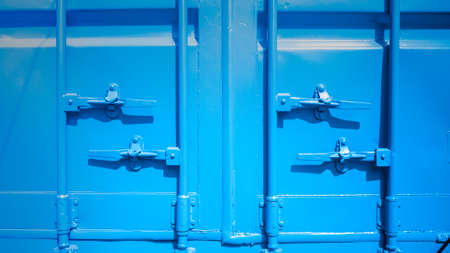 hermetic: Closeup of blue shipping container locks.