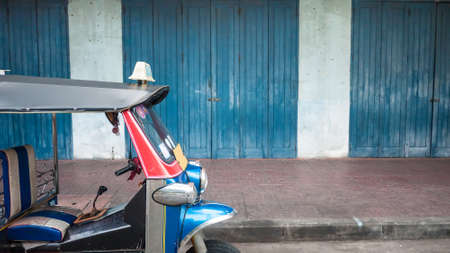 tuk: Blue Tuk Tuk park in front of old house chinese style, Thai traditional taxi in Bangkok Thailand. Stock Photo