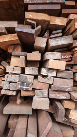 workable: Wooden in stacks, raw material for construction.