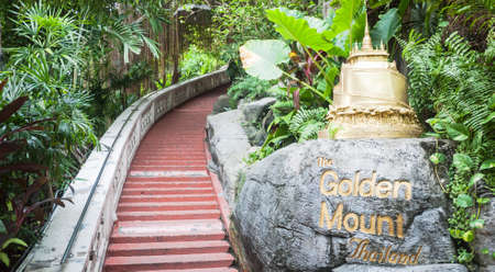 to go up: Bangkok, Thailand - Jan 25, 2016: Mock up of Golden Mount temple in area of Wat Saket Bangkok before go up the stairs.