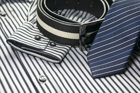 Blue tie on men shirt with belt